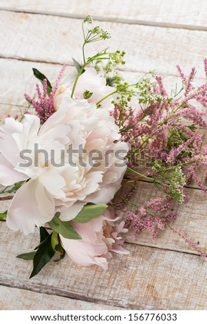 Postcard with fresh flowers of peony. Selective focus. - stock photo