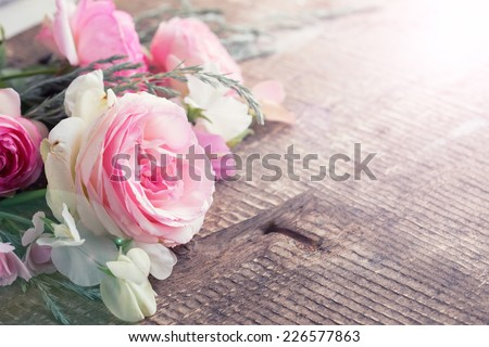 Postcard with fresh roses on  wooden background. Selective focus - stock photo