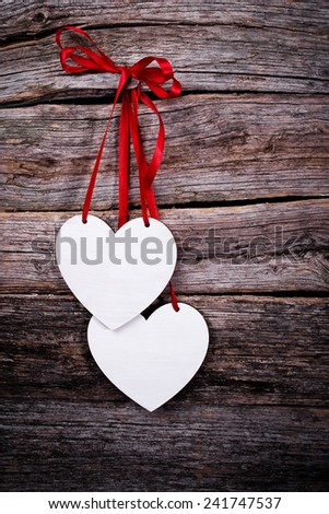 postcard with hearts on a wooden background - stock photo
