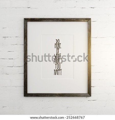 "Poster ""Do more of what makes you happy"" on the brick wall - stock photo"