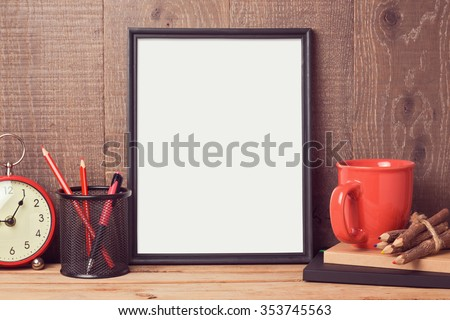 Poster mock up template with business desk objects over wooden background - stock photo