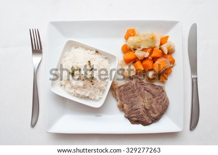 pot-au-feu french gastronomy with beef and rice  - stock photo