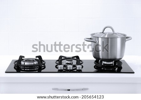 Pot in white modern kitchen - stock photo