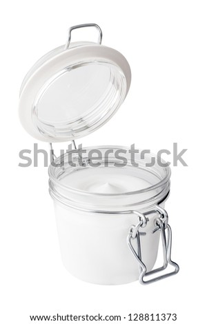 Pot of moisturizing face cream on white background - stock photo