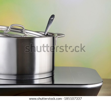 pot on induction hob - stock photo
