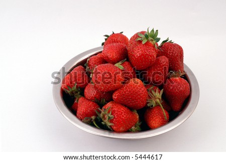 Pot with strawberries. Isolated on white. - stock photo