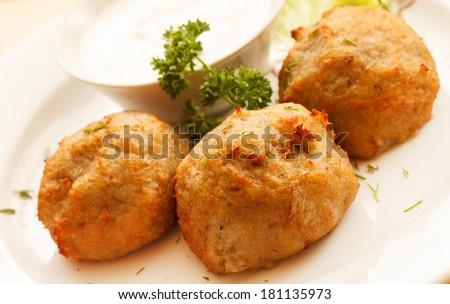 potato balls with sour cream - stock photo