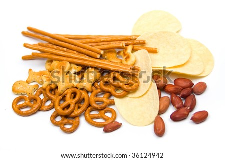 Potato chips and salty snacks isolated on white background - stock photo