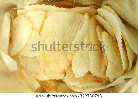 Potato chips bright yellow color is very salty - stock photo
