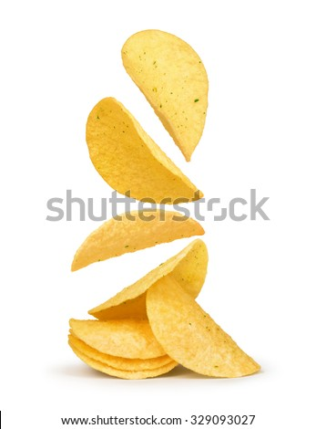 potato chips falling in the air on an isolated white background - stock photo