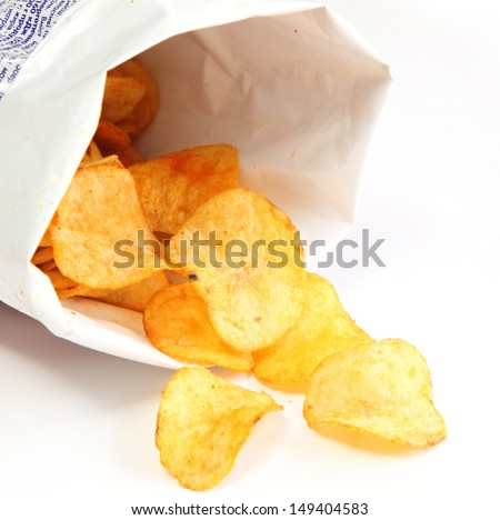 Potato chips in a package isolated on white background - stock photo
