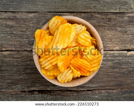 potato chips in a wooden bowl - stock photo