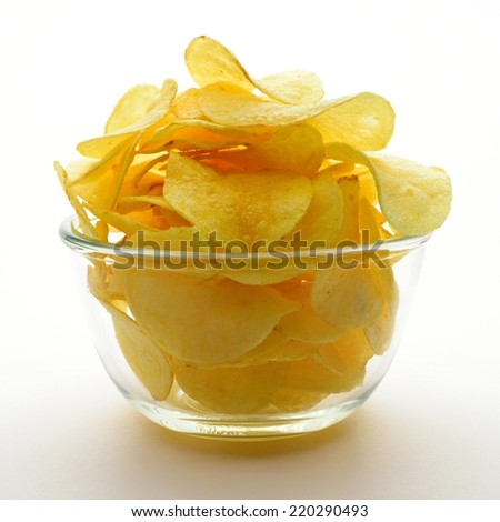 potato chips in bowl isolated on white. - stock photo