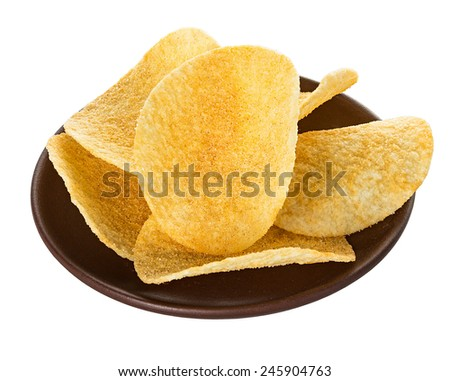Potato chips in bowl isolated on white - stock photo