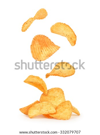 potato chips in the air on an isolated white background - stock photo