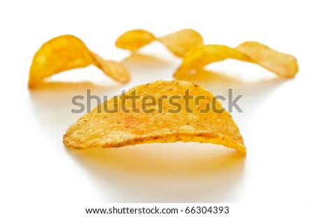 potato chips isolated on white with a shallow depth of field - stock photo