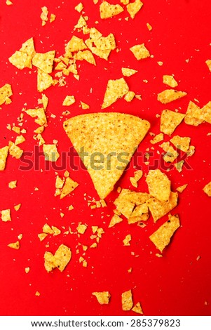Potato chips on a red background - stock photo