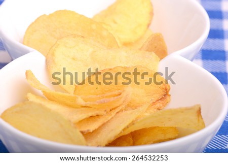 Potato chips on white bowl, close up - stock photo