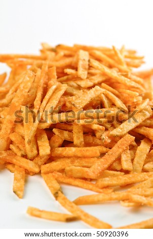 Potato chips sticks with ketchup flavor isolated on white background - stock photo