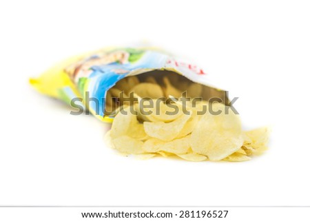 Potato crisp packet opened with crisps spilling out - stock photo