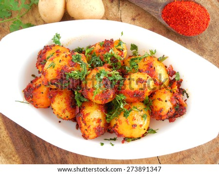 Potato curry made from small potatoes and is used as a side dish for items like chapati and poori. - stock photo