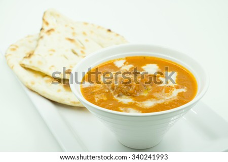 potato curry or aalu masala or aaloo masala with green peas, served with indian bread / roti / chapati / naan / fulka / phulka - stock photo