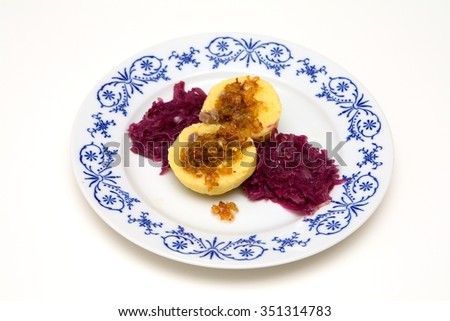 Potato dumplings stuffed with smoked meat and roasted onion - stock photo