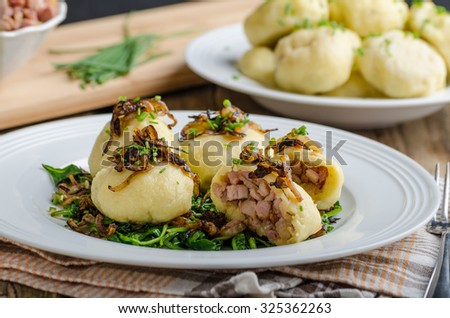Potato dumplings stuffed with smoked meat, czech original meal, very unhealthy, but delicious - stock photo