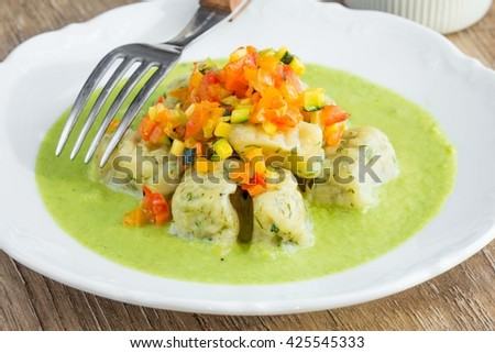 Potato gnocchi in green sauce with chutney vegetables, delicious vegetarian lenten dish - stock photo