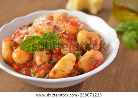 Potato gnocchi with tomato sauce and Parmesan cheese - stock photo