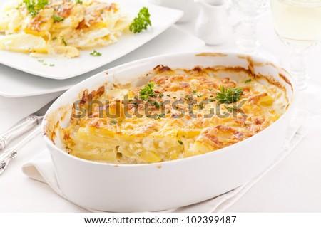 potato gratin with cream and cheese - stock photo