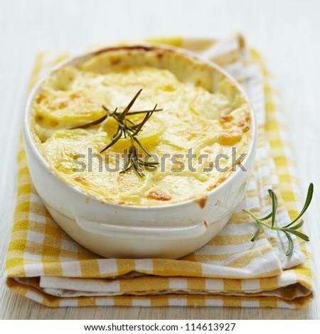 Potato gratin with rosemary - stock photo