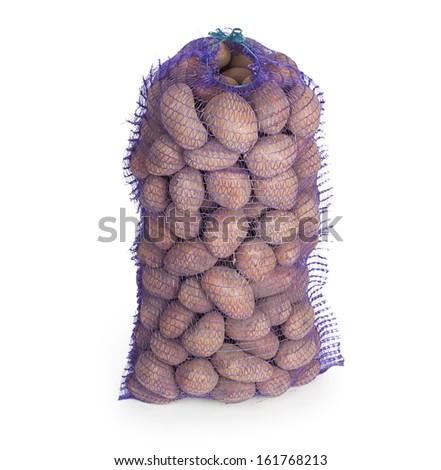 Potato in a bag in white background - stock photo