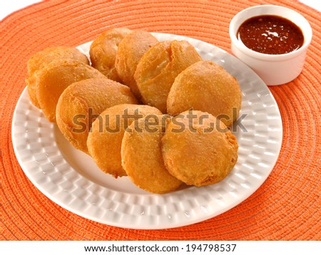 Potato Pakora & Chutney, An extremely delicious and mouth watering snack of Pakistani & Indian Peoples - stock photo