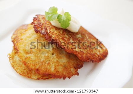 "Potato pancake ""dranik"" with sauce, traditional Ukrainian dish - stock photo"
