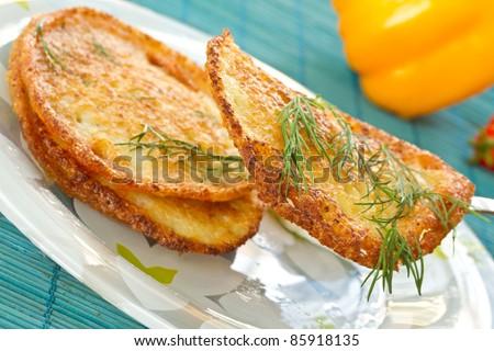 potato pancakes with dill and sour cream closeup - stock photo
