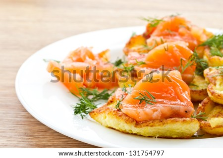 potato pancakes with salted salmon and greens - stock photo