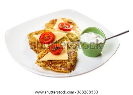 Potato pancakes with sour cream on the plate isolated on white background - stock photo