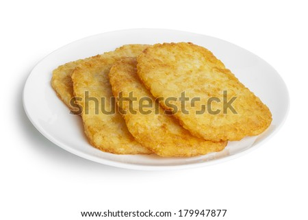 Potato Patties or Hash Browns, front to back focus, isolated on white, clipping path around plate. - stock photo
