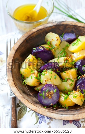 Potato salad with mustard dressing - stock photo