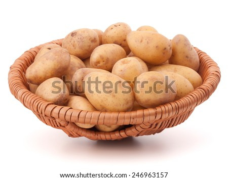 Potato tuber  in wicker basket isolated on white background - stock photo