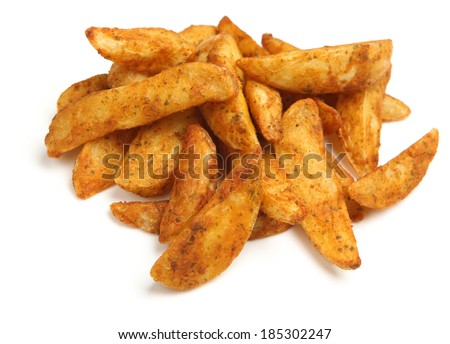 Potato wedges with a spicy Mexican coating. - stock photo