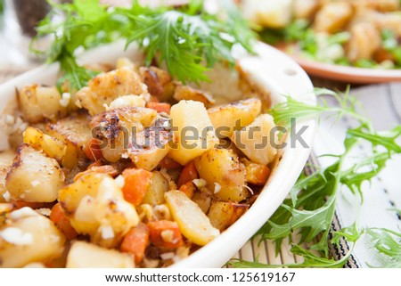 potatoes and carrots cooked in the oven, closeup - stock photo