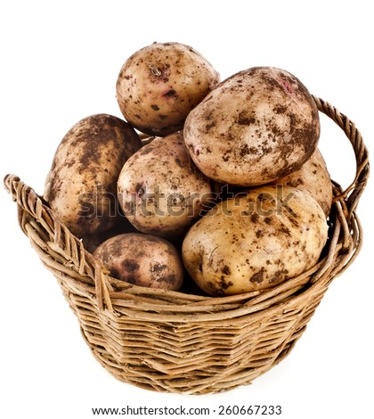 potatoes heap in basket isolated on a white background - stock photo