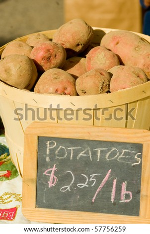 Potatoes in a basket for sale - stock photo