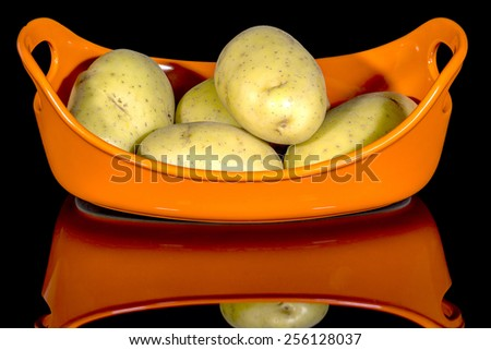 Potatoes in a dish ready to cook - stock photo