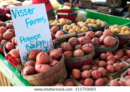 Potatoes in baskets at market - stock photo