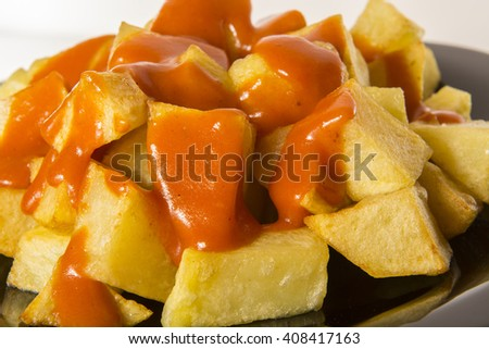 Potatoes in brave sauce - stock photo