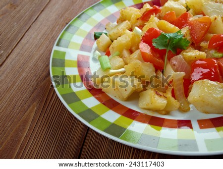Potatoes O'Brien -  dish of pan-fried potatoes along with green and red bell peppers. - stock photo