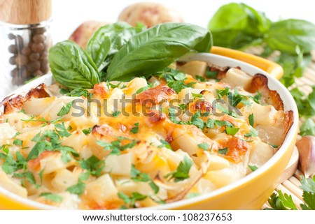 Potatoes with cheese baked in the oven, macro - stock photo